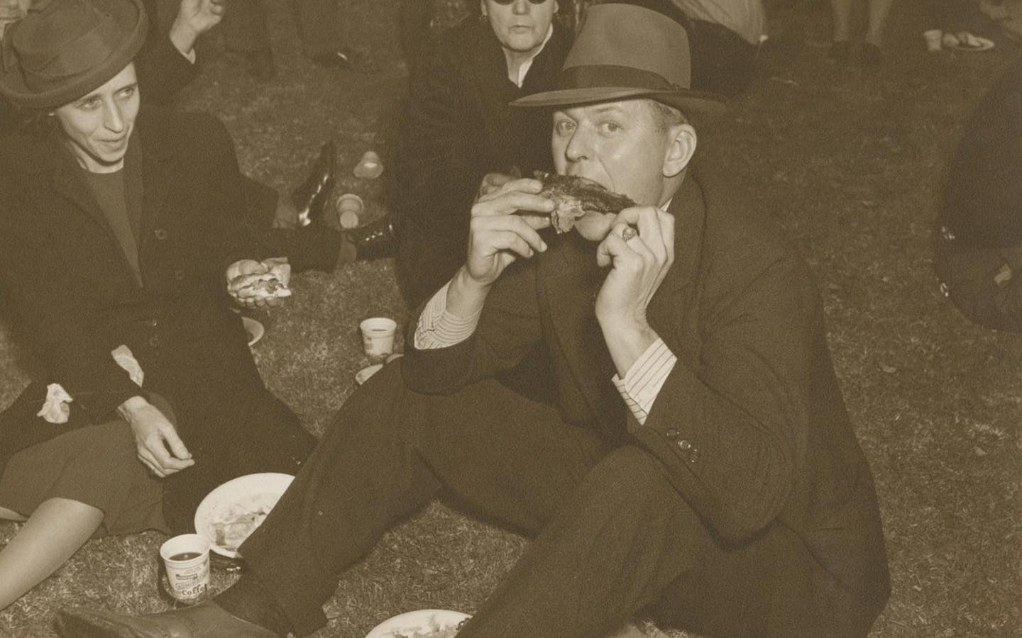 Barbecue cook-offs were rare before the 1970s. In this photo from the early 1940s, a Texas man digs into a rib.